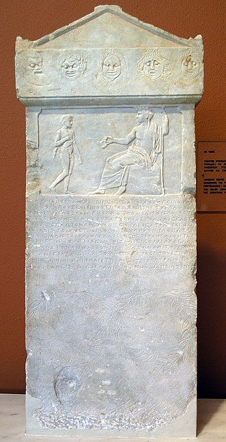 Choregos - Relief of seated Dionysus and satyr; inscription beneath is a decree by the deme Aixone honoring the choregoi Auteas and Philoxenides (313–312 BC)