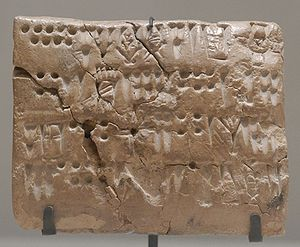 Proto-Elamite - Tablet with numeric signs and script. From Teppe Sialk, Susa, Uruk period (3200 BC to 2700 BC). Department of Oriental Antiquities, Louvre.