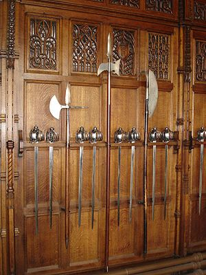 Lochaber axe - Polearms and basket-hilted swords in the Great Hall of Edinburgh Castle. The polearm on the right is a Lochaber axe; the other two are halberds.