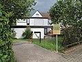 Eingang der Arztpraxis Dr. med. Ulrich Paul - Meinhard-Grebendorf Schwebdaer Str. 3 - panoramio.jpg