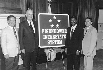 Interstate Highway System - Commemorative sign introduced in 1993. The system was established during Dwight D. Eisenhower's presidency, and the five stars commemorate his rank as General of the Army during World War II.