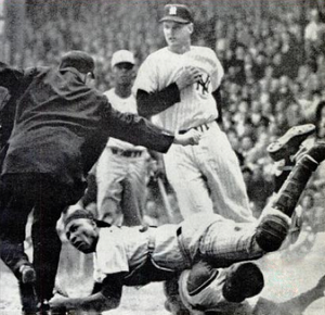 Elston Howard - Howard during a collision at home plate, 1961 World Series. The umpire is Jocko Conlan.