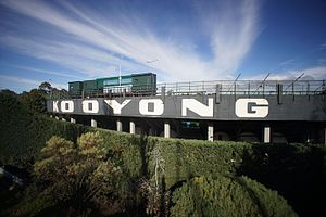 Kooyong Stadium - Image of the exterior grandstand (North) of Kooyong tennis stadium in Melbourne Australia showing iconic lettering and broadcast boxes.