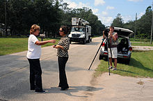 FEMA - 38040 - FEMA Public Information officer gives an interview to a TV reporter.jpg