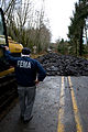 FEMA - 40123 - FEMA PIO on a broken roadway in Washington.jpg