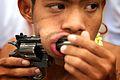 Face Piercing with Gun Phuket Festival.jpg