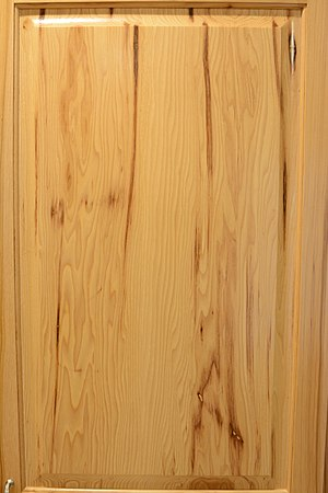 Hickory - Finished hickory in a cabinet