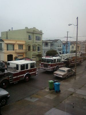 San Francisco Fire Department - Two SFFD truck companies at the scene of a 4th-alarm fire on 41st Ave. in the Sunset District