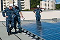 Flickr - Official U.S. Navy Imagery - A CO inspects recently installed solar panels..jpg