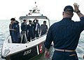 Flickr - Official U.S. Navy Imagery - A Sailor waves farewell to rescued Bahraini fishermen..jpg