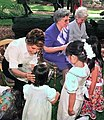 Florida first lady Columba Bush, left, joins former first ladies Donna Lou Askew, center, and Rhea Chiles in greeting children during a Governor's Mansion ceremony.jpg