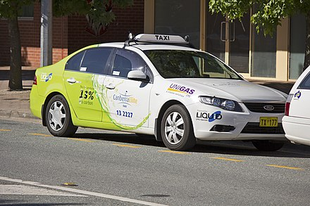 A Canberra Ford Falcon Taxicab Ford FG Falcon running on LPG, operated by Canberra Elite Taxi, photographed in Tuggeranong Town Centre (1).jpg
