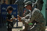 Fort Bragg Paratrooper Hands Out Donations DVIDS289555.jpg