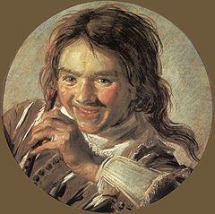 Jeune garçon riant avec une flûte