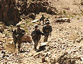 From left, U.S. Army Spc. Daniel S. Kennedy, Sgt. Jeremy N. Butler and Pfc. Brian J. Ure, all infantrymen with the 2nd Battalion, 23rd Infantry Regiment, pause while climbing a ridge to assess security 130224-A-MX357-033.jpg