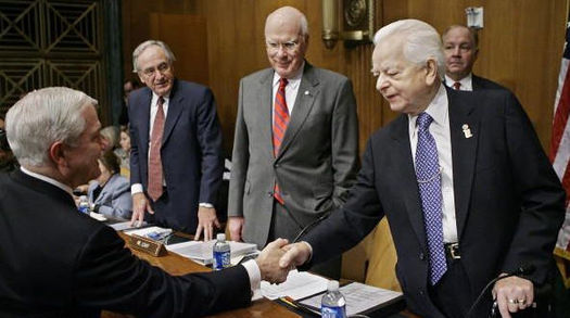 Former Committee Chairman Robert Byrd (D-WV, far right) shakes hands with Secretary of Defense Robert Gates while Sen. Patrick Leahy (D-VT, center right) and Sen. Tom Harkin (D-IA) look on. The hearing was held to discuss further funding for the War in Iraq. GATES APPRO.jpg