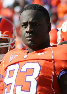 A man in an orange football uniform numbered 93.