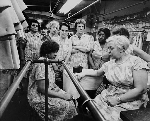 Garment workers listen to funeral service for MLK on portable radio April 8 1968