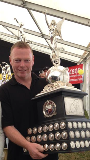 Manx Grand Prix - The late Gary Carswell, Senior race winner in 1997, with the MGP Senior Trophy
