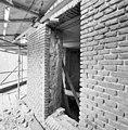 Gedeelte muur vanaf steiger - Houten - 20347302 - RCE.jpg
