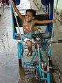 Girl Plays in a Pedicab - Baracoa - Cuba.jpg