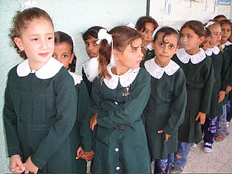 Schoolgirls in Gaza lining up for class, 2009 Girls lining up for class - Flickr - Al Jazeera English.jpg