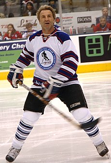 Glenn Anderson skating in full hockey gear (without a helmet).