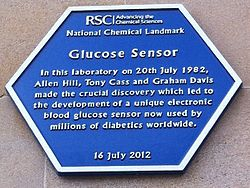 Photo of Allen Hill, Tony Cass, Graham Davis, and Glucose Sensor blue plaque