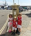 Gold painted post box in honour of Helen Glover's Gold Medal.jpg
