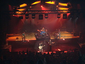 Intelligent lighting - Several intelligent lights in use at a concert. Note the white beams they produce