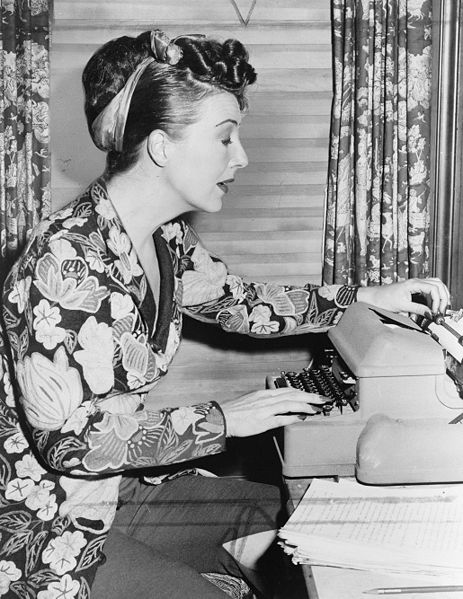 Gypsy Rose Lee at her typewriter, 	  New York World-Telegram and the Sun staff photographer: Palumbo, Fred, photographer.