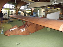 A small glider on display at a museum