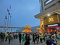 HK TST evening yellow Rubber Duck visitors five Flagpoles May 2013 McDonalds.JPG