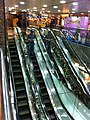 HK Tai Kok Tsui evening 新九龍廣場 New Kowloon Plaza mirror escalators Dec-2012.JPG