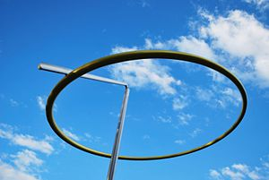 Halo (sculpture) - The ring and arm of Halo pivoting off-centre atop angled mast