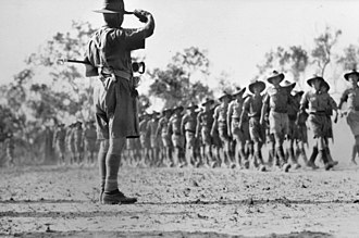 Edmund Herring - Members of the 6th Division march past Major General Herring at Darwin during 1942