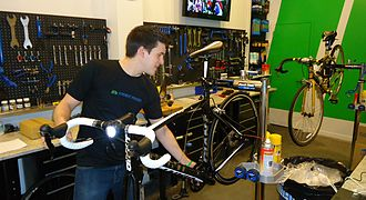 Bicycle mechanic - A mechanic inspects a bicycle in a repair shop