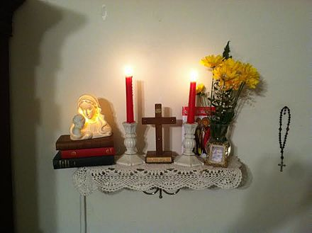 A home altar in a Methodist Christian household, with a cross and candles surrounded by other religious items Home Altar.jpg
