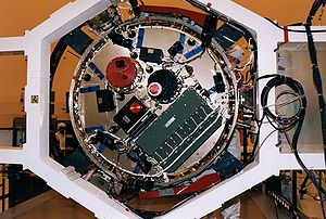 Huygens (spacecraft) - A worker in the Payload Hazardous Servicing Facility (PHSF) stands behind the bottom side of the experiment platform for Huygens.