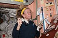 ISS-37 Karen Nyberg prepares to eat a snack in the Unity node.jpg