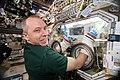 ISS-56 Drew Feustel works with the glovebox inside the Destiny lab.jpg