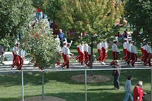 Iowa State University Cyclone Marching Band - The band on parade under the trees surrounding Jack Trice Stadium before a game