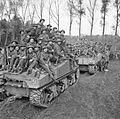 Infantry of 51st Highland Division are carried into battle aboard Sherman tanks near Udenhout, Holland, 29 October 1944. B11457.jpg
