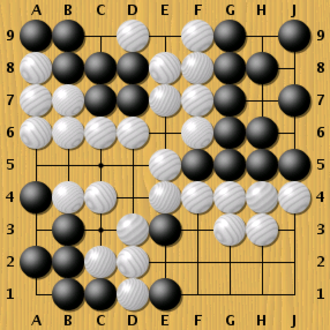 Go strategy and tactics - In the top right Black has 4 eyes, making that group alive.  In the bottom left, Black is not so lucky. That group only has one eye, with no hope of making a second, meaning that the group cannot avoid being captured. (White can play at C3, then A5, then A3, then A1, but this is not necessary; the Black group is dead as it stands.)