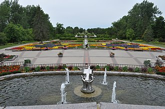 International Peace Garden - A view of the fountain and flower gardens. The central division divides Canada (right) from the USA (left).
