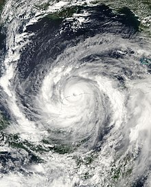 Satellite imagery of a mature hurricane entering the Gulf of Mexico.