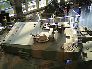 Tanks of the post–Cold War era - Japanese Type 90 tank at the JGSDF public information center. Note the large bustle area for the autoloader, as well as the configuration of the grenade launchers.