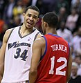 JaVale McGee laughs at or with Evan Turner.jpg