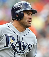 "baseball player in a grey uniform that says ""RAYS"" in navy letters across the front"