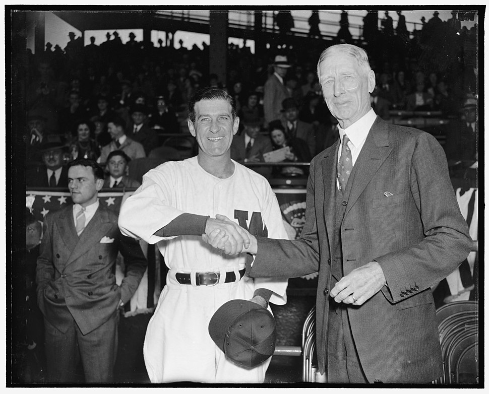 Just another handshaking. Washington, D.C., April 18. The traditional handshaking was repeated today as Bucky Harris and Connie Mack gripped each other just before their teams went into LCCN2016873413